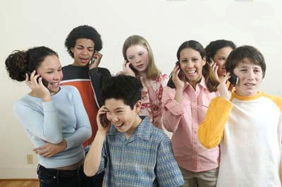 group of mixed teens on phone