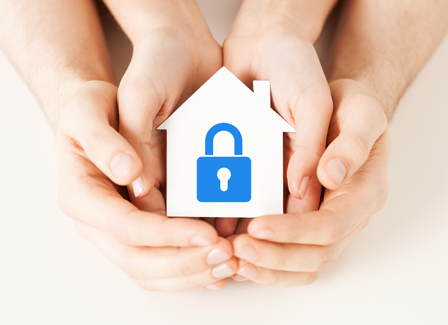 real estate and family home security concept - closeup picture o